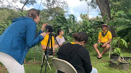 Students in the North Shore Ethnographic Field School conduct interviews with Moki Labra in Waialua, O'ahu
