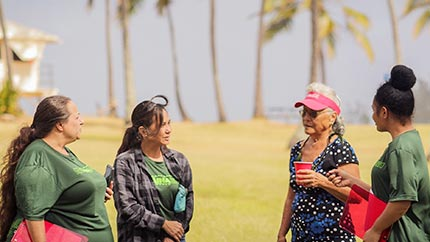 Students in the North Shore Ethnographic Field School conduct interviews with Judy Miram in Waialua, O'ahu