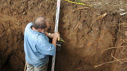 Collecting sediments for paleoenvironmental studies, Mo'orea, Society Islands (French Polynesia).